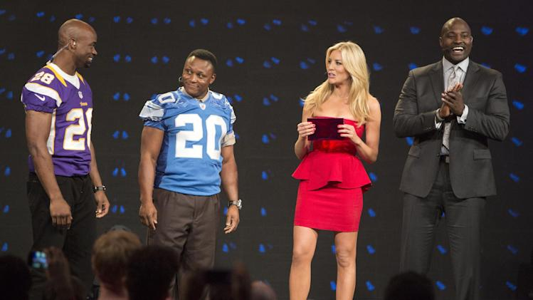 IMAGE DISTRIBUTED FOR EA SPORTS - Minnesota Vikings running back Adrian Peterson, left, and hall of fame running back Barry Sanders, (20), wait for he results of the Madden 25 fan based cover vote during the EA Sports Madden NFL 25 Cover Reveal hosted by Charissa Thompson, center, and Marcellus Wiley, right, on SportsNation, Wednesday, April, 24, 2013 in New York. (Photo by Chris Park/Invision for EA Sports/AP Images)