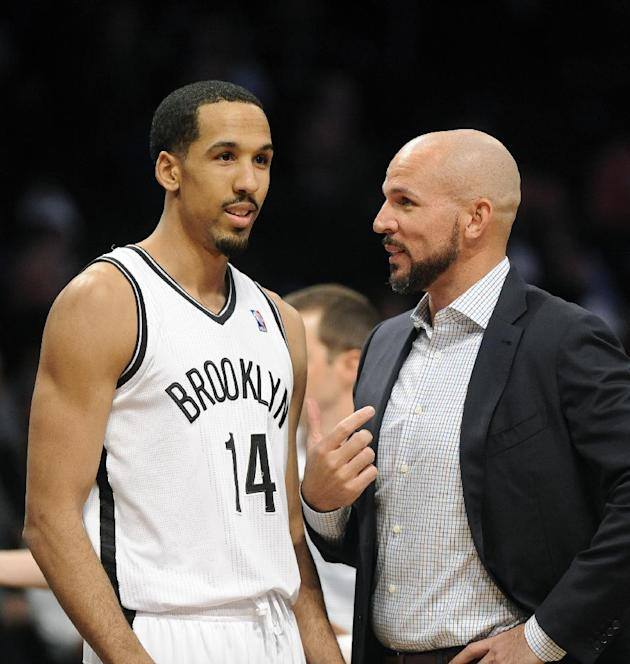 Brooklyn Nets coach Jason Kidd talks with  Shaun Livingston (14) during the first half of an NBA basketball game against the  Sacramento Kings on Sunday, March 9, 2014 at Barclays Center in New York.