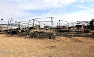 The charred remains of a vegetable market are seen in the town of Bani Walid on October 31