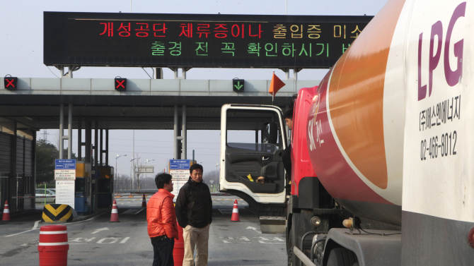 South Korean drivers wait to head the North Korea's city of Kaesong, at the customs, immigration and quarantine office in Paju, South Korea, near the border village of Panmunjom, Thursday, April 4, 2013. North Korea on Wednesday barred South Korean workers from entering a jointly run factory park just over the heavily armed border in the North, officials in Seoul said, a day after Pyongyang announced it would restart its long-shuttered plutonium reactor and increase production of nuclear weapons material. (AP Photo/Ahn Young-joon)