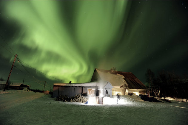 In this March 9, 2011 file photo, the aurora borealis, or northern lights, fill the sky above the Takotna, Alaska  checkpoint during the Iditarod Trail Sled Dog Race.  Some folks are predicting 2012 w