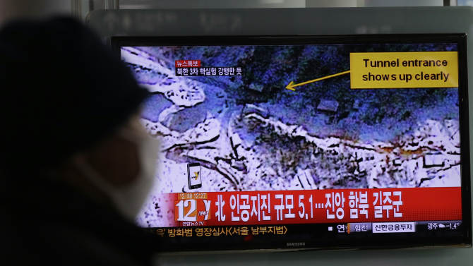 """A South Korean watches news reporting about a possible nuclear test conducted by North Korea on a TV screen at the Seoul train station in Seoul, South Korea, Tuesday, Feb. 12, 2013. The U.S. Geological Survey said Tuesday it had detected a magnitude 4.9 earthquake in North Korea, but neither Pyongyang nor Seoul confirmed whether North Korea had conducted its widely anticipated third nuclear test. The writing reads """"North, Artificial earthquake 5.1."""" (AP Photo/Lee Jin-man)"""
