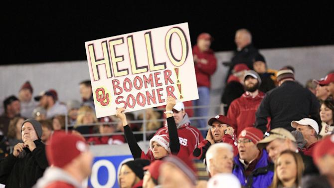 Oklahoma fans cheer on their side at the start of the second half during their NCAA college football game against West Virginia in Morgantown, W.Va., on Saturday, Nov. 17, 2012. Oklahoma won 50-49. (AP Photo/Christopher Jackson)