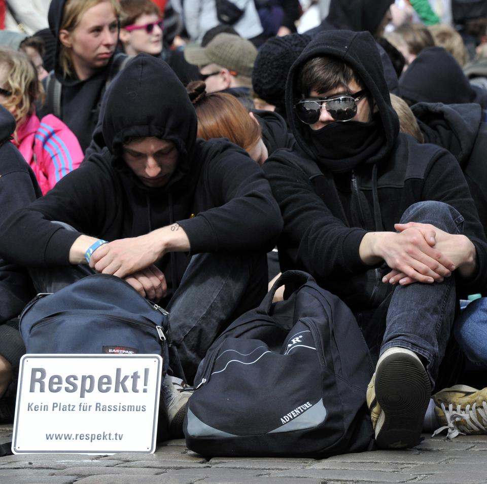 "Participants of a sit-in block a street to protest against an election campaign of the German right-wing party NDP in Neumuenster, northern Germany, Tuesday, May 1, 2012. Board reads ""Respect! No space for racism"". (AP Photo/dapd, Tim Riediger)"