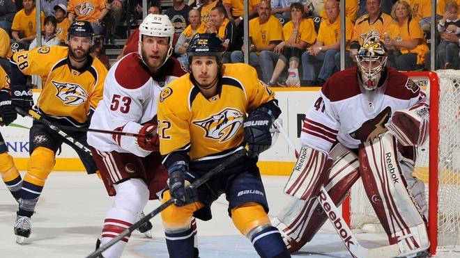 Jordin Tootoo #22 Of The Nashville Predators And Derek Morris #53 Of The Phoenix Coyotes Try To Get Position In Front Getty Images