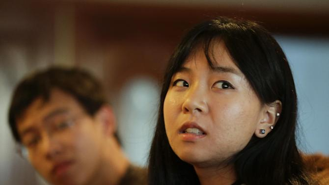 In this Monday, March 11, 2012 photo, Victoria Hu, 20, right, and her brother Richard talk about their father at their house in Rancho Palos Verdes, Calif. On Thanksgiving weekend in 2008, Victoria, then 16, awaited her workaholic father's return from a business trip to China. Then her mother got word of a delay, though she insisted he'd be home by Christmas. In time, she learned the truth: Her father, a Chinese-American engineer, had been arrested on charges of stealing Chinese state secrets. Even though authorities dropped all charges, he still isn't home because of a bizarre set of legal circumstances that prohibit him from leaving China. (AP Photo/Chris Carlson)