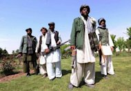 Former Taliban fighters join Afghan government forces during a ceremony in Herat province on April 26. Pakistan, Afghanistan and the United States agreed Friday to look at ways to provide safe passage to Afghan Taliban who are willing to join the peace process, officials said