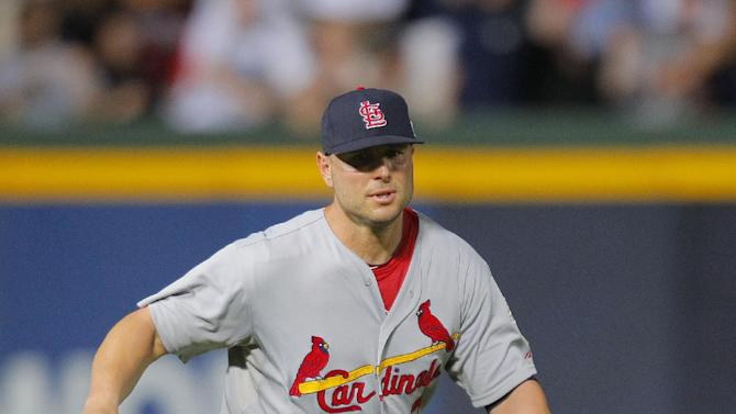 St. Louis Cardinals left fielder Matt Holliday runs to a ball hit by Atlanta Braves' Andrelton Simmons during the eighth inning of the National League wild card playoff baseball game on Friday, Oct. 5, 2012, in Atlanta. The game was stopped after officials decided Simmons was out on the infield fly rule. (AP Photo/Todd Kirkland)