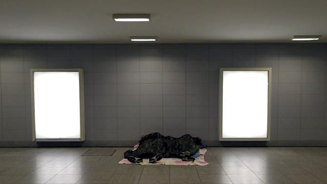 Migrants sleep outside a train station in Budapest