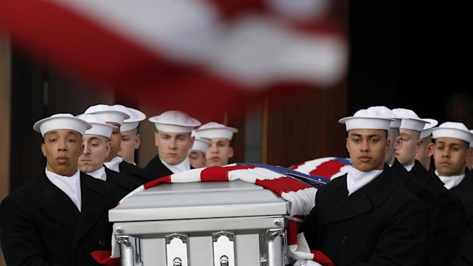 Two Navy Honor Guard teams carry two caskets of remains as they depart Fort Meter Memorial Chapel during services to honor two sailors from the Civil War ship, the USS Monitor, Friday, March 8, 2013 in Arlington, Va. A century and a half after the Civil War ship the USS Monitor sank, two unknown crewmen found in the ironclad's turret were buried at Arlington National Cemetery. Friday's burial may be the last time Civil War soldiers are buried at the cemetery. (AP Photo/Alex Brandon)