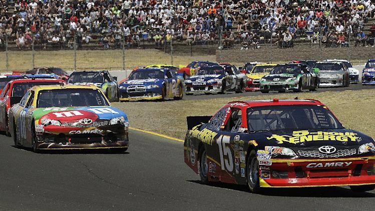 Clint Bowyer (15) leads the pack during the NASCAR Sprint Cup Series auto race, Sunday, June 24, 2012, in Sonoma, Calif. (AP Photo/Ben Margot)