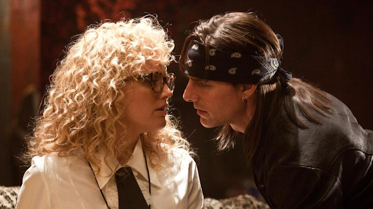 "This film image released by Warner Bros. Pictures shows Malin Akerman as Constance Sack, left, and Tom Cruise as Stacee Jaxx in New Line Cinema's rock musical ""Rock of Ages,"" a Warner Bros. Pictures release. (AP Photo/Warner Bros. Pictures)"