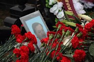 Flowers are laid on the grave of Russian lawyer Sergei Magnitsky at Preobrazhenskoye cemetery in Moscow, November 20, 2009. A Moscow court resumed preliminary hearings Monday in the posthumous trial of a Russian lawyer whose death in jail after accusing state officials of tax fraud has upset the Kremlin's delicate ties with the US