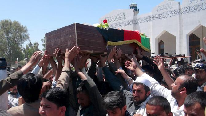 Afghans carry the body of a border policeman killed in a clash with Pakistani troops in the Gushta district of Jalalabad east of Kabul, Afghanistan, Thursday, May 2, 2013. An Afghan border policeman was killed in what appeared to be an exchange of fire with Pakistani troops along the country's eastern border, an Afghan security official said Thursday.(AP Photo/Nisar Ahmad)