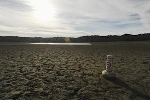 A buoy meant for boaters rests on the dry bed of Lake Mendocino, a key Mendocino County reservoir, in Ukiah