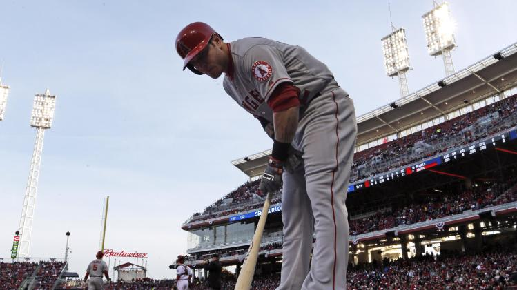 Los Angeles Angels' Josh Hamilton prepares to bat in the first inning of a baseball game against the Cincinnati Reds, Wednesday, April 3, 2013, in Cincinnati. (AP Photo/Al Behrman)