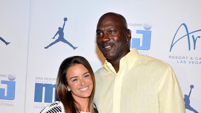 From right, Charlotte Bobcats owner Michael Jordan and fiancee model Yvette Prieto arrive at the Michael Jordan Celebrity Invitational opening night dinner, Wednesday, April, 3, 2013 in Las Vegas. (Photo by Jeff Bottari/Invision for Jordan/AP Images)