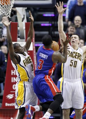 Detroit Pistons guard Rodney Stuckey, center, loses the ball as he attempts a last-second shot between Indiana Pacers guard Darren Collison, left, and forward Tyler Hansbrough in the second half of an NBA basketball game in Indianapolis, Wednesday, Feb. 23, 2011. The Pacers defeated the Pistons 102-101. (AP Photo/Michael Conroy)