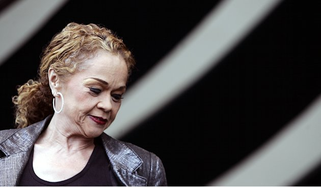 In this April 29, 2006 photo, Etta James performs during the 2006 New Orleans Jazz and Heritage Festival in New Orleans.  James, the feisty rhythm and blues singer whose raw, passionate vocals anchore