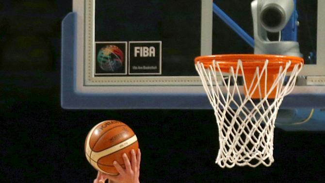 Canada's Kelly Olynyk goes for the basket against Cuba's Jasiel Rivero during their 2015 FIBA Americas Championship basketball game