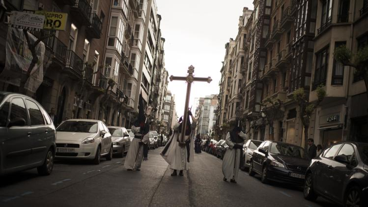 Penitents take part in the Procesion de la Esperanza in Bilbao