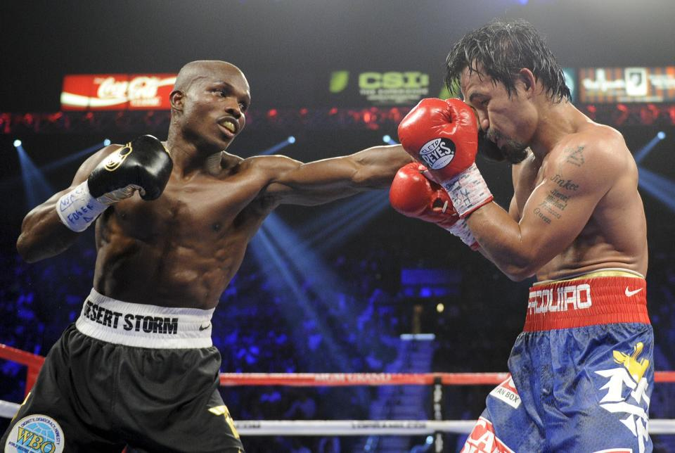 Timothy Bradley, from Palm Springs, Calif., left, lands a punch against Manny Pacquiao, from the Philippines, in their WBO world welterweight title fight Saturday, June 9, 2012, in Las Vegas. Bradley won the fight by split decision. (AP Photo/Chris Carlson)