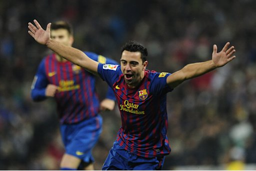 Barcelona's midfielder Xavi Hernandez celebrates after Real Madrid's Brazilian defender Marcelo scored an own goal during the quot;El clasicoquot; Spanish League football match Real Madrid against Barcelona at the Santiago Bernabeu stadium in Madrid on December 10, 2011. AFP PHOTO/JAVIER SORIANO (Photo credit should read JAVIER SORIANO/AFP/Getty Images)