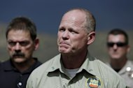 Jim Karels, an investigator from the Florida Forest Service speaks to reporters after he arrived in Yarnell, Ariz., to kick off the investigation into the deaths of 19 firefighters, Wednesday, July 3, 2013. An elite crew of firefighters was overtaken by the out-of-control blaze on Sunday, killing 19 members as they tried to protect themselves from the flames under fire-resistant shields. (AP Photo/Chris Carlson)