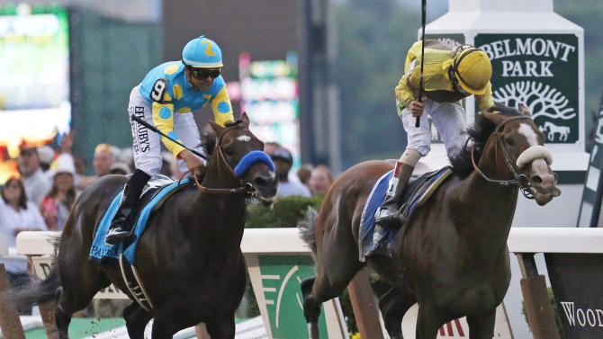 Union Rags, right, with jockey John Velazquez, holds off Paynter, with jockey Mike Smith, to win the Belmont Stakes horse race at Belmont Park in Elmont, N.Y., on Saturday, June 9, 2012. (AP Photo/Mark Lennihan)