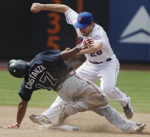 New York Mets' Daniel Murphy, right, attempts to tag out Atlanta Braves' Jose Constanza (17) who steals second base during the seventh inning of a baseball game on Sunday, Aug. 7, 2011, at Citi Field in New York. Murphy was injured on the play. (AP Photo/Frank Franklin)