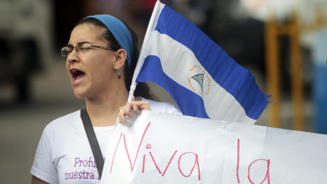 Member of civil organisations protests against the construction of Nicaragua's planned $50 billion shipping canal and in support of the protesters detained during a protest in El Tule on December 24, in Managua