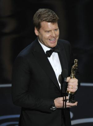 "John Kahrs accepts the award for best animated short film for ""Paperman"" during the Oscars at the Dolby Theatre on Sunday Feb. 24, 2013, in Los Angeles.  (Photo by Chris Pizzello/Invision/AP)"