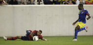 U.S. midfielder Danny Williams, left, slips while trying to dribble the ball against Ecuador defender Walter Ayovi in the first half of an international soccer friendly game, Tuesday, Oct. 11, 2011, in Harrison, N.J. (AP Photo/Julio Cortez)