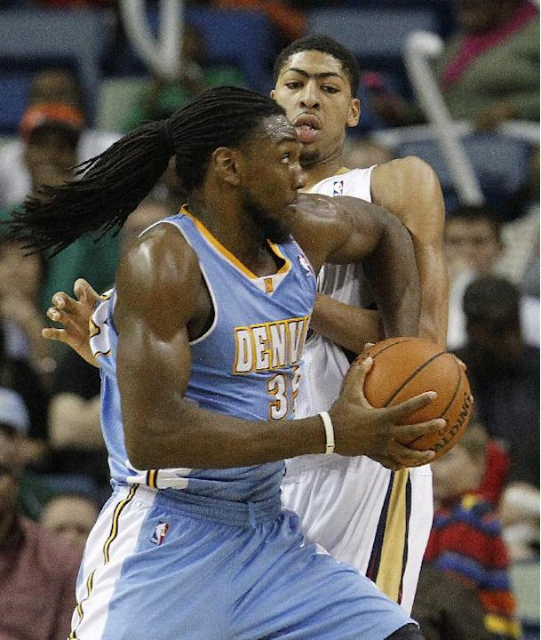 Denver Nuggets power forward Kenneth Faried (35) fights his way past New Orleans Pelicans power forward Anthony Davis (23) in overtime in an NBA basketball game in New Orleans, Sunday, March 9, 2014.