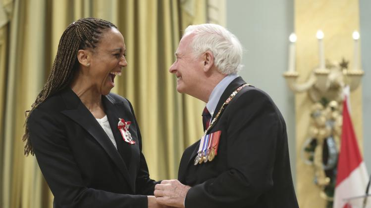 Former Canadian Olympic athlete Crooks shakes hands with Governor General Johnston after being awarded the Order of Canada at Rideau Hall in Ottawa