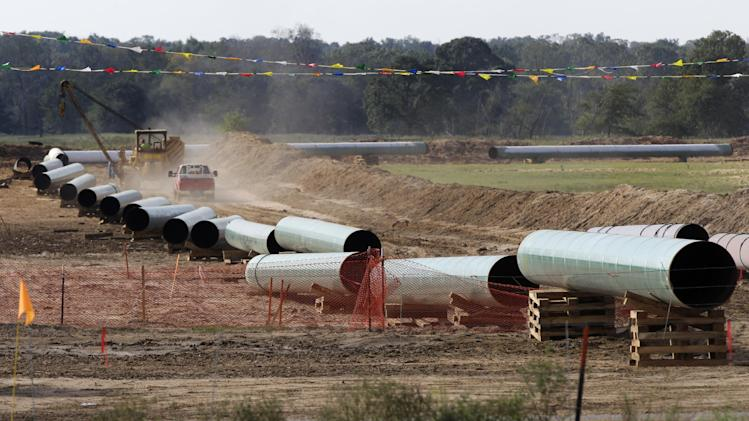 File - In this Oct. 4, 2012 file photo, large sections of pipe are shown in Sumner Texas. Safety regulators have quietly placed two extra conditions on construction of TransCanada Corp.'s Keystone XL oil pipeline after learning of potentially dangerous construction defects involving the pipeline's southern leg. The new conditions were added four months after the pipeline safety agency sent TransCanada two warning letters about defects and other construction problems on the Keystone Gulf Coast Pipeline, which extends from Oklahoma to the Texas Gulf Coast. (AP Photo/Tony Gutierrez, file)