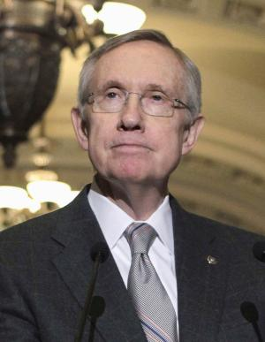 FILE - In this Aug. 2, 2011 file photo, Senate Majority Leader Harry Reid of Nev. takes part in a news conference on Capitol Hill in Washington. Congress has reached a bipartisan compromise to end the partial shutdown of the Federal Aviation Administration that has left 74,000 transportation and construction workers idled, Reid said Thursday. (AP Photo/J. Scott Applewhite, File)
