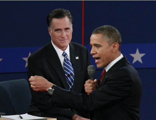 US President Obama speaks next to Republican presidential candidate Romney during second US presidential campaign debate in Hempstead