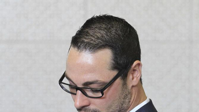 CORRECTS DATE - Carl Pistorius, brother of murder accused Oscar Pistorius, stands inside the court for his culpable homicide case at the Magistrate Court  in Vanderbijlpark, South Africa on Thursday April 25, 2013. (AP Photo/Themba Hadebe)