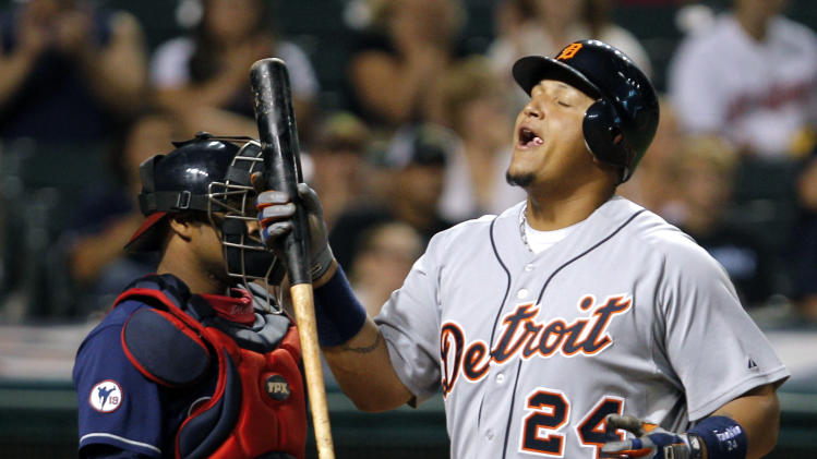 Detroit Tigers' Miguel Cabrera walks away from the plate after striking out in the sixth inning of a baseball game against the Cleveland Indians Tuesday, Aug. 9, 2011, in Cleveland. At left is Indians catcher Carlos Santana. (AP Photo/Amy Sancetta)