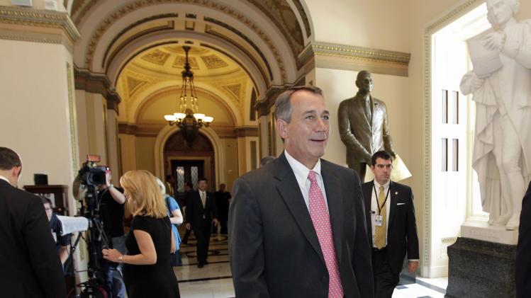 House Speaker John Boehner of Ohio, walks from the House floor on Capitol Hill in Washington, Friday, June 24, 2011, during debate over funding for U.S. military action in Libya.  (AP Photo/J. Scott Applewhite)