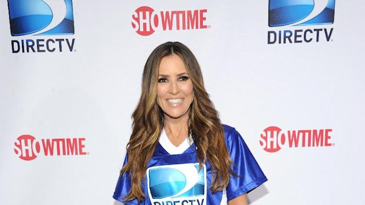 Jillian Barberie arrives at DIRECTV's Seventh Annual Celebrity Beach Bowl, on Saturday, Feb. 2, 2013 in New Orleans. (Photo by Evan Agostini/Invision/AP)