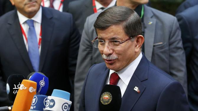 Turkish Prime Minister Davutoglu arrives to attend the EU-Turkey summit in Brussels
