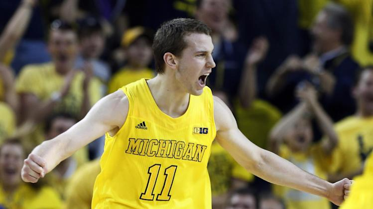 Michigan guard Nik Stauskas (11) reacts after Michigan hit a three-point shot during the first half of an NCAA college basketball against Indiana game Sunday, March 10, 2013, in Ann Arbor, Mich. (AP Photo/Duane Burleson)