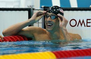 Michael Phelps celebrates winning the men&#x2019;s 100-meter butterfly final. (Getty Images)