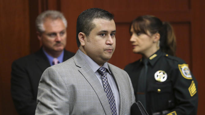 George Zimmerman arrives for the 17th day of his trial in Seminole circuit court, Tuesday, July 2, 2013 in Sanford, Fla. Zimmerman is charged with 2nd-degree murder in the fatal shooting of Trayvon Martin, an unarmed teen, in 2012. (AP Photo/Orlando Sentinel, Joe Burbank, Pool)