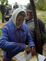 A woman casts her ballot during in the village of Svidno. Belarus on Monday boasted of a massive turnout in parliamentary polls won by supporters of authoritarian President Alexander Lukashenko but the opposition ridiculed the results as brazenly rigged