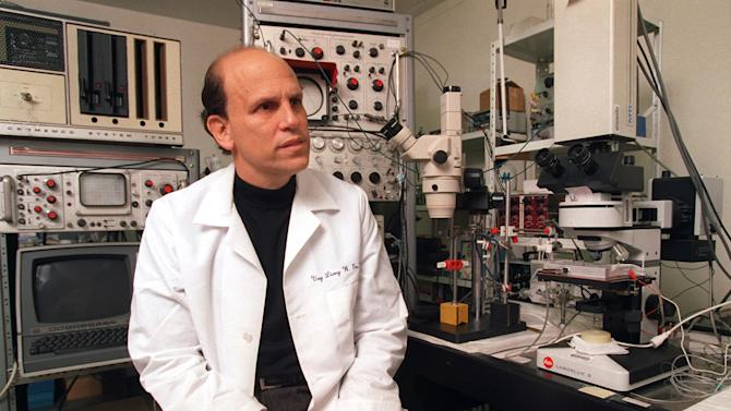 """FILE - In this Friday, March 1, 1996, file photo, Michael Milken, the famed ex-junk bond financier who once was at the center of the biggest Wall Street securities fraud scandal, poses for a photo while visiting the UCLA Nutrition Research Laboratory in the Westwood area of Los Angeles. George Washington University will name its public health school for Michael Milken, the 1980s king of Wall Street """"junk"""" bonds who spent 22 months in prison but later devoted himself to philanthropy and advocated for medical research. On Tuesday,  March 11, 2014, the university announced gifts totaling $80 million to address public health challenges from Milken and Sumner Redstone. (AP Photo/Damian Dovarganes)"""