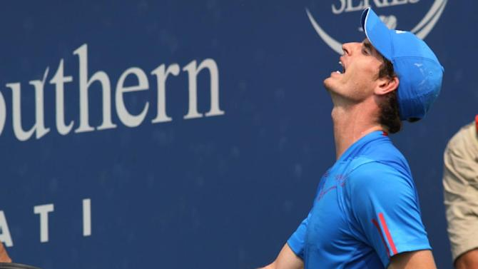 Andy Murray, of Great Britain, reacts after losing a point to Jeremy Chardy, of France, during a match at the Western & Southern Open tennis tournament, Thursday Aug. 16, 2012, in Mason, Ohio. Chardy won 6-4, 6-4. (AP Photo/Tom Uhlman)