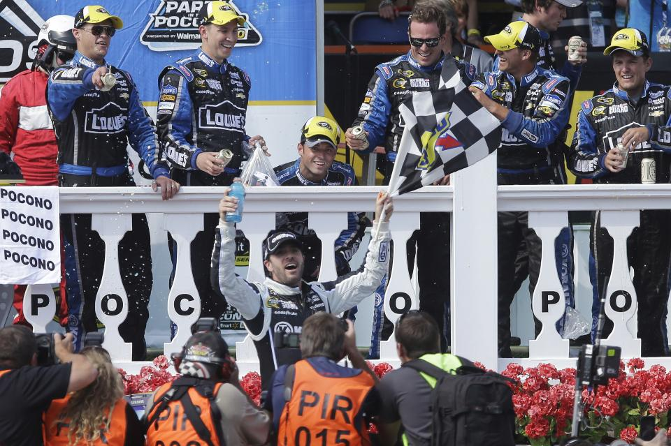 Jimmie Johnson, center, celebrates in Victory Lane after winning the NASCAR Pocono 400 auto race on Sunday, June 9, 2013, in Long Pond, Pa. (AP Photo/Mel Evans)